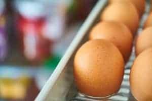 refrigerated eggs in a refrigerator door