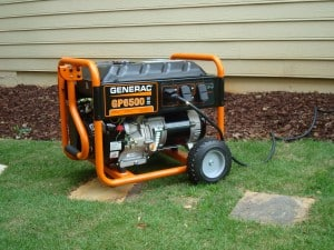 A Generac Portable Generator providing power to a house through a 240-volt cable.