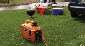 Generac portable inverter generator in the orange case with carry handle.