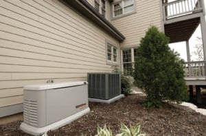 A generac standby generator installed outside a home