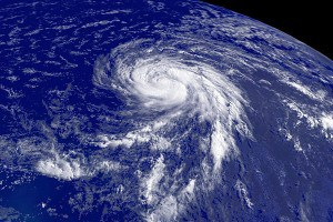 Photo from space of a hurricane-class tropical cyclone showing circular motion and storm bands.