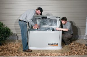 Technicians work on a Generac Home Backup Generator