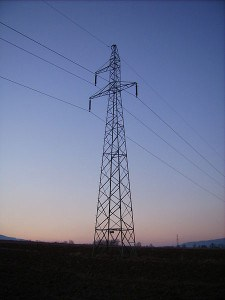 Transmission tower supporting high-voltage electrical transmission cables.
