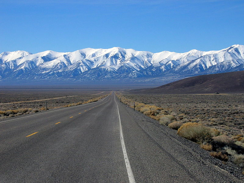 Highway 50 in Nevada appears to end at the base of snow-capped mountains.