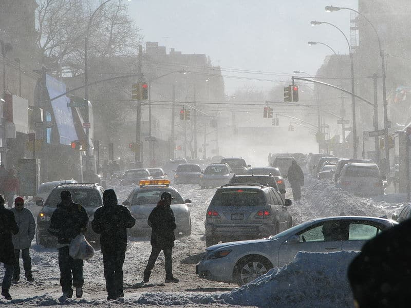 New York City streets clogged with cars and drivers after a snowstorm.