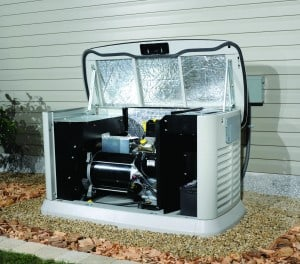 A standby generator with the top lifted and front panel removed to show the interal components such as engine and alternator.