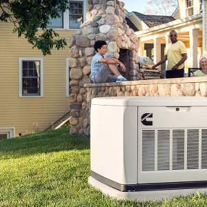 Cummins Quiet Connect Standby Generator In a Home's Backyard with Deck and Family