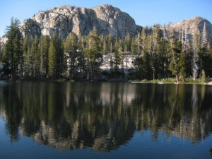 Mountain, sky, and forest reflected in a lake