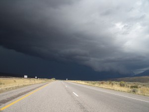 An approaching storm with dark clouds and a squall line.