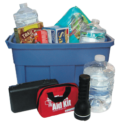 A blue plastic tub filled with emergency supplies including food, water, first aid kit, and numerous other items.