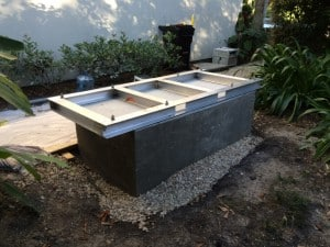 The custom frame and pedestal build by Cyril Laan to keep the generator unit off thre ground and out of flood waters.