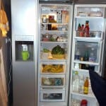 A side-by-side refrigerator-freezer with the refrigerator door open.