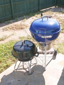Two charcoal kettle grills.