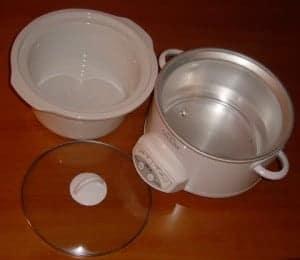 A modern crock pot and it's parts.