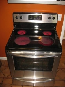 An electric range will all stove-top burners and oven elements turned on.