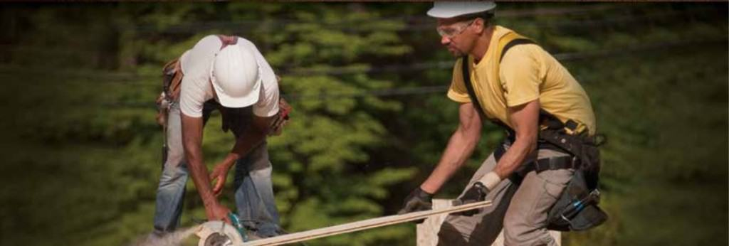 Men using power tools on a construction site