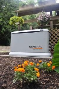 Guardian standby generator installed near a deck