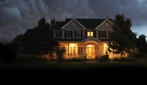 Home with lights on to deter thieves and others.