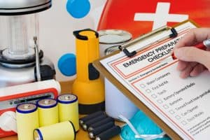 Checking disaster supplies against a list.
