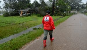 Red Cross Air Working Approaching Damaged Home