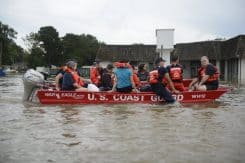 Harvey Victims evacuate in a United States Coast Guard Rescue Boat.