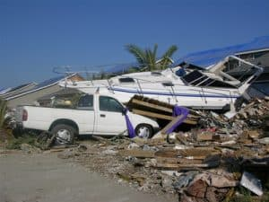 Debris Pile After a Hurricane with car and boat amidst other wreckage