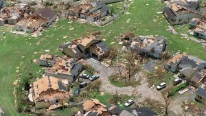 Damaged homes mising roofs after Hurricane Andrew