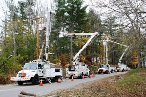 Utility Workers Repairing Storm-Damaged Power Lines