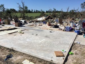 A concrete slab marks the remains of a two-story brick home after an EF4 tornado