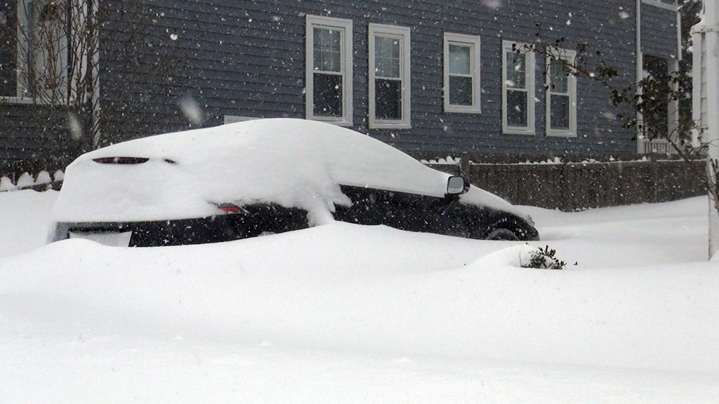A car nearly buried by snow after a March Nor'Easter