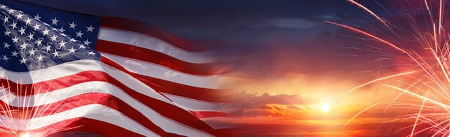 The United States Flag at Sunset with Fireworks