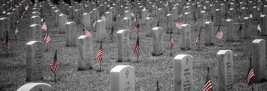 Flags decorate the graves a cemetery for soldiers who died in war.