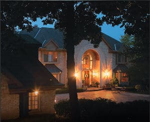 Home with a Briggs and Stratton Backup Generator has the lights on during a power outage.