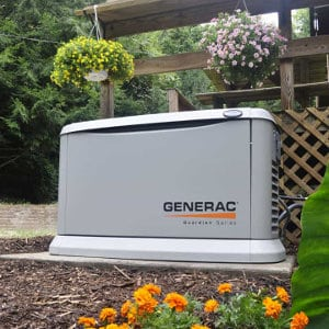 Generac Guardian Series Generator Installed in Back Yard Near House and Deck