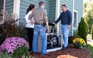 Generac Installer with Homeowners—Generac Guardian Installation