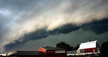 The signature bow-shaped shelf cloud associated with a Derecho.