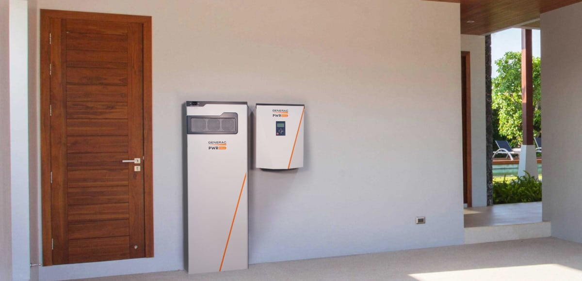 A Generac PWRcell installation in a garage including the battery cabinet and inverter.