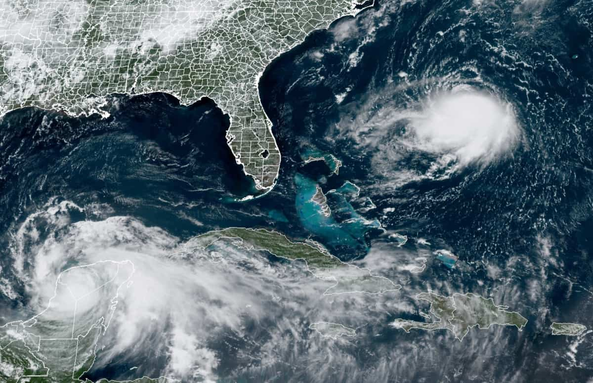 Hurricanes Grace (lower left) and Henri (upper right) over Yucatan Mexico and the Atlantic Ocean. NOAA GOES16 satellite image